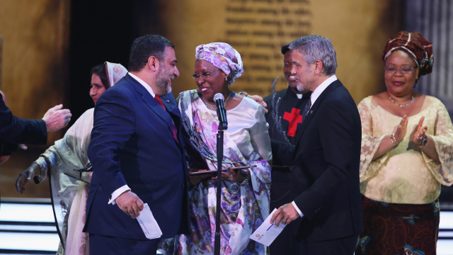 Marguerite Barankitse accepts the inaugural Aurora Prize for Awakening Humanity from George Clooney