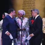 Marguerite Barankitse accepts the 2016 Aurora Prize for Awakening Humanity from George Clooney