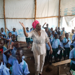 Aurora Prize Laureate Marguerite Barankitse sings with school children at the Maison Shalom project