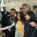 George Clooney takes a photo with students during a visit to UWC Dilijan