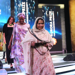 Marguerite Barankitse and Syeda Ghulam Fatima depart stage