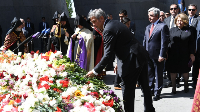 George Clooney lays a flower at the Armenian Genocide Memorial