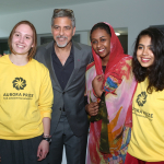 George Clooney meets Aurora Prize volunteers