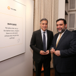 George Clooney and Ruben Vardanyan at the pledge wall